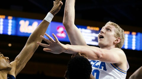 UCLA center Thomas Welsh, right, shoots against South Carolina forward Ian Kinard, left, during the first half of an NCAA college basketball game Friday, Nov. 17, 2017, in Los Angeles. (AP Photo/Ringo H.W. Chiu)