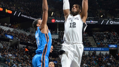 SAN ANTONIO, TX - NOVEMBER 17: LaMarcus Aldridge #12 of the San Antonio Spurs attempts a dunk against the Oklahoma City Thunder on November 17, 2017 at the AT&T Center in San Antonio, Texas. NOTE TO USER: User expressly acknowledges and agrees that, by downloading and or using this photograph, user is consenting to the terms and conditions of the Getty Images License Agreement. Mandatory Copyright Notice: Copyright 2017 NBAE (Photos by Mark Sobhani/NBAE via Getty Images)