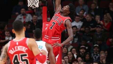 CHICAGO, IL - NOVEMBER 17: Justin Holiday #7 of the Chicago Bulls dunks the ball against the Charlotte Hornets on November 17, 2017 at the United Center in Chicago, Illinois. NOTE TO USER: User expressly acknowledges and agrees that, by downloading and or using this photograph, user is consenting to the terms and conditions of the Getty Images License Agreement. Mandatory Copyright Notice: Copyright 2017 NBAE (Photo by Gary Dineen/NBAE via Getty Images)