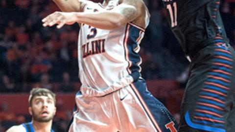 Illinois guard Te'Jon Lucas (3) shoots as DePaul guard Eli Cain (11) defends during an NCAA college basketball game Friday, Nov. 17, 2017, in Champaign, Ill. (Robin Scholz/The News-Gazette via AP)