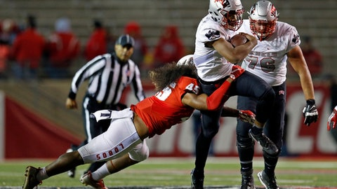 UNLV quarterback Armani Rogers is stopped by New Mexico linebacker Evahelotu Tohi (45) during the first half of an NCAA college football game in Albuquerque, N.M., Friday, Nov. 17, 2017. (AP Photo/Andres Leighton)