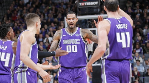 SACRAMENTO, CA - NOVEMBER 17: Willie Cauley-Stein #00 of the Sacramento Kings gives high five to teammates during the game against the Portland Trail Blazers on November 17, 2017 at Golden 1 Center in Sacramento, California. NOTE TO USER: User expressly acknowledges and agrees that, by downloading and or using this photograph, User is consenting to the terms and conditions of the Getty Images Agreement. Mandatory Copyright Notice: Copyright 2017 NBAE (Photo by Rocky Widner/NBAE via Getty Images)
