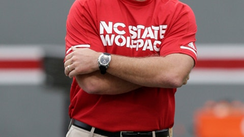 FILE- This Nov. 4, 2017, file photo shows North Carolina State head coach Dave Doeren watches prior to an NCAA college football game against Clemson in Raleigh, N.C.  With an Atlantic Coast Conference title no longer a possibility, No. 25 North Carolina State is refocusing on winning its version of a state championship. The Wolfpack wrap up the regular season with two games against annual instate rivals, starting Saturday night at Wake Forest and concluding next week with a visit from North Carolina. (AP Photo/Gerry Broome, File)