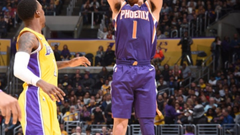 LOS ANGELES, CA - NOVEMBER 17: Devin Booker #1 of the Phoenix Suns shoots the ball against the Los Angeles Lakers on November 17, 2017 at STAPLES Center in Los Angeles, California. NOTE TO USER: User expressly acknowledges and agrees that, by downloading and/or using this photograph, user is consenting to the terms and conditions of the Getty Images License Agreement. Mandatory Copyright Notice: Copyright 2017 NBAE (Photo by Andrew D. Bernstein/NBAE via Getty Images)