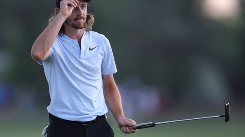 Tommy Fleetwood of England reacts to his fans on the 18th fairway during the third round of the DP World Tour Championship golf tournament in Dubai, United Arab Emirates, Saturday, Nov. 18, 2017. (AP Photo/Kamran Jebreili)