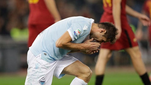 Lazio's Senad Lulic reacts after missing a scoring chance during an Italian Serie A soccer match between AS Roma and Lazio, at the Olympic stadium in Rome, Saturday, Nov. 18, 2017. (AP Photo/Andrew Medichini)