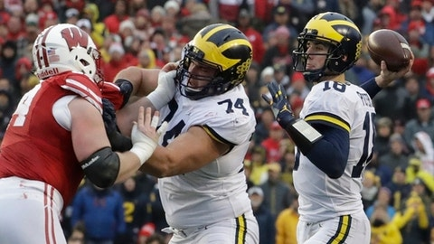 Michigan quarterback Brandon Peters throws during the first half of an NCAA college football game against the WisconsinSaturday, Nov. 18, 2017, in Madison, Wis. (AP Photo/Morry Gash)