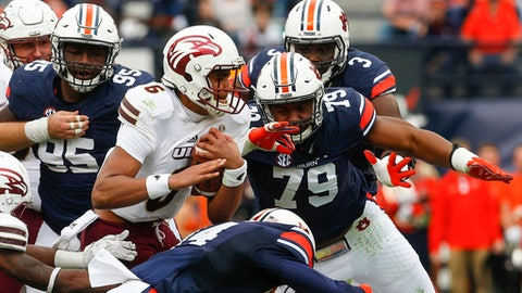 Louisiana Monroe quarterback Caleb Evans (6) carries the ball as Auburn defensive lineman Andrew Williams (79) and defensive back Stephen Roberts (14) close in for the tackle during the first half of an NCAA college football game, Saturday, Nov. 18, 2017, in Auburn, Ala. (AP Photo/Butch Dill)