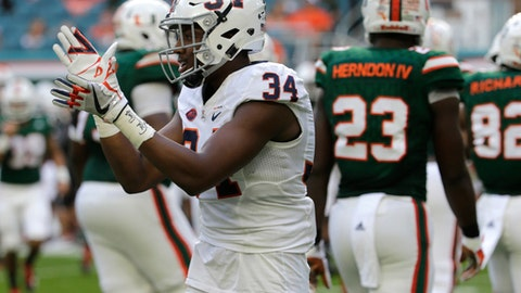 Virginia cornerback Bryce Hall (34) claps after the Virginia defense stopped Miami on third down during the first half of an NCAA college football game, Saturday, Nov. 18, 2017, in Miami Gardens, Fla. (AP Photo/Lynne Sladky)