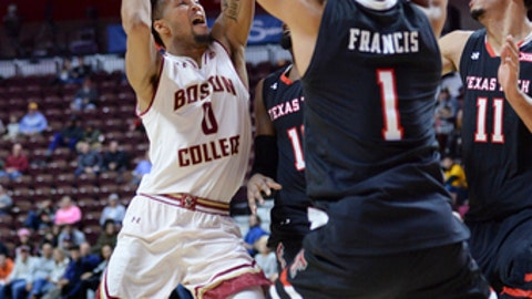 Boston College's guard Ky Bowman (0) drives against Texas Tech's guard Brandone Francis (1) and Zach Smith (11) in the second half of an NCAA college basketball game against Boston College Saturday, Nov. 18, 2017, in Uncasville, Conn. Texas Tech won, 75-64. (AP Photo/Stephen Dunn)