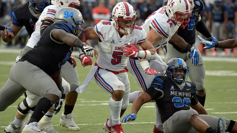 SMU running back Xavier Jones (5) carries the ball against Memphis defensive lineman Joseph Dorceus (94) in the second half of an NCAA college football game Saturday, Nov. 18, 2017, in Memphis, Tenn. (AP Photo/Brandon Dill)
