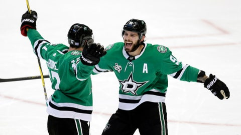 Dallas Stars center Devin Shore (17) celebrates his goal with teammate Dallas Stars center Tyler Seguin (91) during the second period of an NHL hockey game against the Edmonton Oilers in Dallas, Saturday, Nov. 18, 2017. (AP Photo/LM Otero)