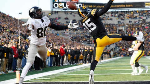 Iowa defensive back Josh Jackson (15) breaks up a pass intended for Purdue wide receiver Jarrett Burgess (80) during the first half of an NCAA college football game, Saturday, Nov. 18, 2017, in Iowa City, Iowa. (AP Photo/Charlie Neibergall)