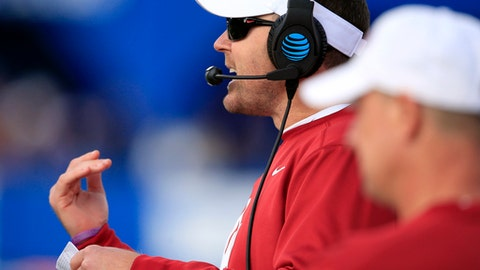 Oklahoma head coach Lincoln Riley signals a play during the first half of an NCAA college football game against Kansas in Lawrence, Kan., Saturday, Nov. 18, 2017. (AP Photo/Orlin Wagner)