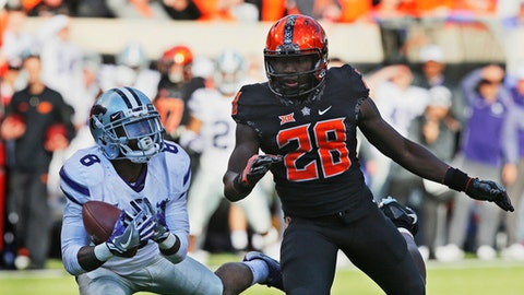 Kansas State defensive back Duke Shelley (8) intercepts a pass intended for Oklahoma State wide receiver James Washington (28) in the first half of an NCAA college football game in Stillwater, Okla., Saturday, Nov. 18, 2017. (AP Photo/Sue Ogrocki)