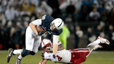 Penn State's Mike Gesicki (88) gets upended by Nebraska's Marcus Newby (3) after a catch during the first half of an NCAA college football game in State College, Pa., Saturday, Nov. 18, 2017. (AP Photo/Chris Knight)