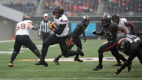 Arizona State running back Demario Richard breaks through the Oregon State defense for a touchdown in the first half of an NCAA college football game, in Corvallis, Ore., Saturday, Nov. 18, 2017. (AP Photo/Timothy J. Gonzalez)