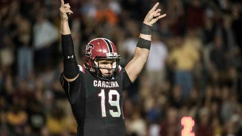 South Carolina quarterback Jake Bentley (19) celebrates a touchdown against Wofford during the second half of an NCAA college football game on Saturday, Nov. 18, 2017 in Columbia, S.C. South Carolina defeated Wofford 31-10. (AP Photo/Sean Rayford)