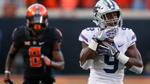 Kansas State wide receiver Byron Pringle (9) catches a pass in front of Oklahoma State cornerback Rodarius Williams (8) and carries it in for a touchdown in the second half of an NCAA college football game in Stillwater, Okla., Saturday, Nov. 18, 2017. Kansas State won 45-40. (AP Photo/Sue Ogrocki)