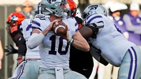 Kansas State quarterback Skylar Thompson (10) throws in the first half of an NCAA college football game against Oklahoma State in Stillwater, Okla., Saturday, Nov. 18, 2017. Kansas State won 45-40.(AP Photo/Sue Ogrocki)