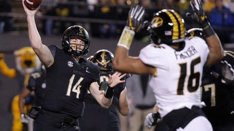 Vanderbilt quarterback Kyle Shurmur (14) passes as he is pressured by Missouri defensive lineman Marcell Frazier (16) in the first half of an NCAA college football game Saturday, Nov. 18, 2017, in Nashville, Tenn. (AP Photo/Mark Humphrey)