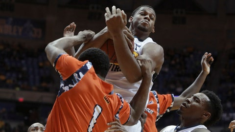 West Virginia forward Sagaba Konate (50) grabs a rebound from Morgan State guard LaPri McCray-Pace (1) during the first half of an NCAA college basketball game, Saturday, Nov. 18, 2017, in Morgantown, W.Va. (AP Photo/Raymond Thompson)