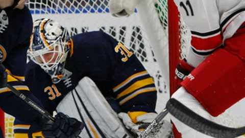 Buffalo Sabres goalie Chad Johnson (31) stops Carolina Hurricanes forward Jordan Staal (11) during the second period of an NHL hockey game, Saturday Nov. 18, 2017, in Buffalo, N.Y. (AP Photo/Jeffrey T. Barnes)