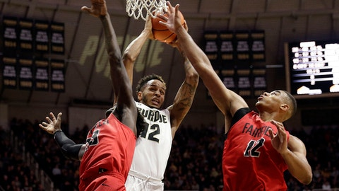 Purdue forward Vince Edwards, center, pulls down a rebound between Fairfield defenders Ferron Flavors Jr., left, and Kevin Senghore-Peterson in the second half of an NCAA college basketball game in West Lafayette, Ind., Saturday, Nov. 18, 2017. Purdue won 106-64. (AP Photo/AJ Mast)