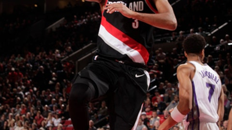 PORTLAND, OR - NOVEMBER 18: CJ McCollum #3 of the Portland Trail Blazers goes to the basket against the Sacramento Kings on November 18, 2017 at the Moda Center in Portland, Oregon. NOTE TO USER: User expressly acknowledges and agrees that, by downloading and or using this Photograph, user is consenting to the terms and conditions of the Getty Images License Agreement. Mandatory Copyright Notice: Copyright 2017 NBAE (Photo by Cameron Browne/NBAE via Getty Images)