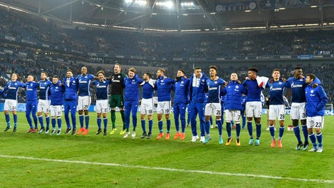 Schalke's team celebrates after the German Bundesliga soccer match between FC Schalke 04 and Hamburg SV in Gelsenkirchen, Germany, Sunday Nov. 19, 2017. Schalke defeated Hamburg with 2-0 and is now on the second place of the table behind Bayern. (AP Photo/Martin Meissner)