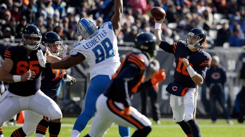 Chicago Bears quarterback Mitchell Trubisky (10) throws a pass as Detroit Lions defensive end Jeremiah Ledbetter (98) tries to block during the first half of an NFL football game, Sunday, Nov. 19, 2017, in Chicago. (AP Photo/Nam Y. Huh)