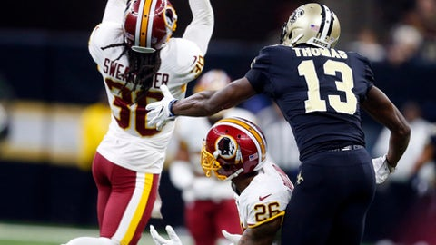Washington Redskins free safety D.J. Swearinger (36) intercepts a pass intended for New Orleans Saints wide receiver Michael Thomas (13) in the first half of an NFL football game in New Orleans, Sunday, Nov. 19, 2017. (AP Photo/Butch Dill)