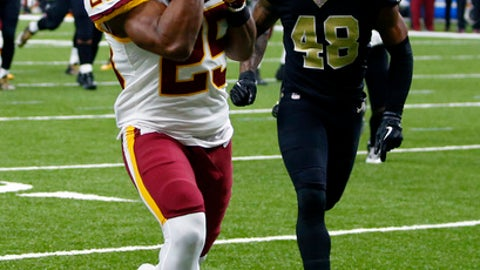 Washington Redskins running back Chris Thompson (25) pulls in a touchdown reception in front of New Orleans Saints free safety Vonn Bell (48) in the first half of an NFL football game in New Orleans, Sunday, Nov. 19, 2017. (AP Photo/Butch Dill)