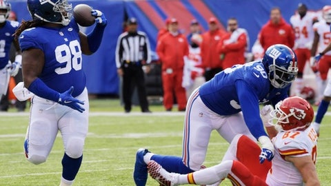 New York Giants defensive tackle Damon Harrison (98) intercepts a pass to Kansas City Chiefs' Travis Kelce during the first half of an NFL football game Sunday, Nov. 19, 2017, in East Rutherford, N.J. (AP Photo/Bill Kostroun)