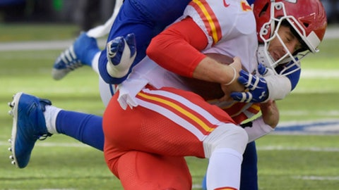 New York Giants defensive end Jason Pierre-Paul (90) sacks Kansas City Chiefs quarterback Alex Smith (11) during the first half of an NFL football game Sunday, Nov. 19, 2017, in East Rutherford, N.J. (AP Photo/Bill Kostroun)