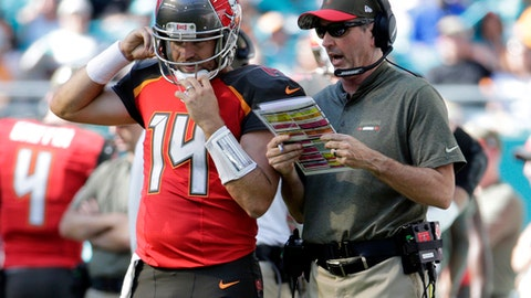 Tampa Bay Buccaneers head coach Dirk Koetter talks to quarterback Ryan Fitzpatrick (14), during the first half of an NFL football game against the Miami Dolphins, Sunday, Nov. 19, 2017, in Miami Gardens, Fla. (AP Photo/Lynne Sladky)