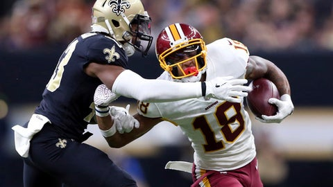 Washington Redskins wide receiver Josh Doctson (18) tries to fend off New Orleans Saints free safety Marcus Williams in the first half of an NFL football game in New Orleans, Sunday, Nov. 19, 2017. (AP Photo/Rusty Costanza)