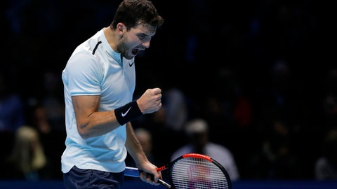 Grigor Dimitrov of Bulgaria celebrates after winning the first set against David Goffin of Belgium during the men's singles final of the ATP World Finals at the O2 Arena in London, Sunday, Nov. 19, 2017. (AP Photo/Alastair Grant)