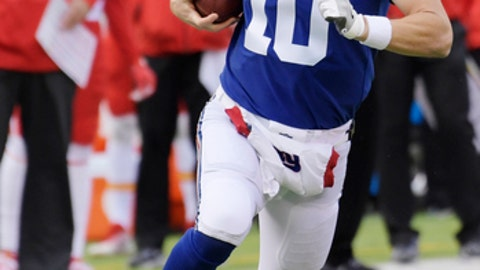 New York Giants quarterback Eli Manning (10) rushes during the first half of an NFL football game against the Kansas City Chiefs Sunday, Nov. 19, 2017, in East Rutherford, N.J. (AP Photo/Bill Kostroun)