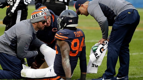 Trainers check on Chicago Bears outside linebacker Leonard Floyd (94) during the second half of an NFL football game against the Detroit Lions, Sunday, Nov. 19, 2017, in Chicago. (AP Photo/Nam Y. Huh)