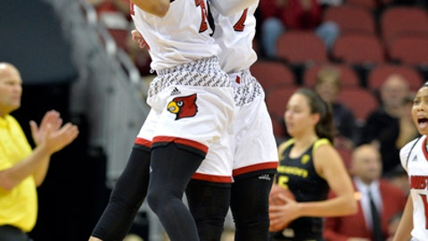 Louisville guard Asia Durr (25) and forward Myisha Hines-Allen (2) celebrate during a timeout in the first half of an NCAA college basketball game against Oregon, Sunday, Nov. 19, 2017, in Louisville, Ky. (AP Photo/Timothy D. Easley)