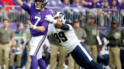 Minnesota Vikings quarterback Case Keenum (7) throws a pass ahead of Los Angeles Rams defensive end Aaron Donald, right, during the first half of an NFL football game, Sunday, Nov. 19, 2017, in Minneapolis. (AP Photo/Bruce Kluckhohn)
