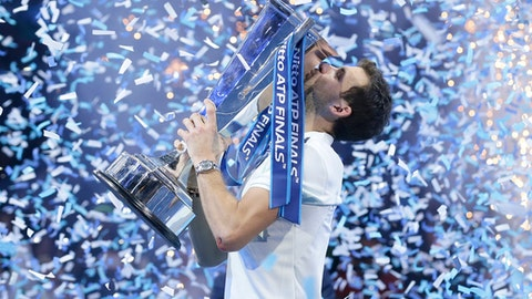 Grigor Dimitrov of Bulgaria lifts the trophy after defeating David Goffin of Belgium in their ATP World Tour Finals singles final tennis match at the O2 Arena in London, Sunday Nov. 19, 2017. (AP Photo/Tim Ireland)
