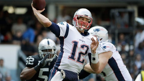 New England Patriots quarterback Tom Brady (12) passes against the Oakland Raiders during the first half of an NFL football game Sunday, Nov. 19, 2017, in Mexico City. (AP Photo/Rebecca Blackwell)