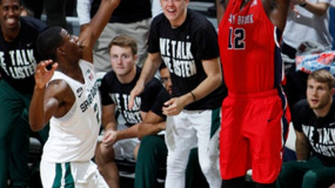 Stony Brook's Tyrell Sturdivant, right, shoots against Michigan State's Jaren Jackson Jr. during the first half of an NCAA college basketball game, Sunday, Nov. 19, 2017, in East Lansing, Mich. (AP Photo/Al Goldis)