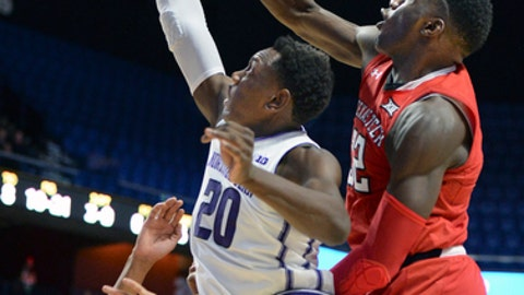 Northwestern's Scottie Lindsey (20) scores against Texas Tech center Norense Odiase (32) in the first half of an NCAA college basketball game Sunday, Nov. 19, 2017, at the Mohegan Sun Arena in Uncasville, Conn. (AP Photo/Stephen Dunn)