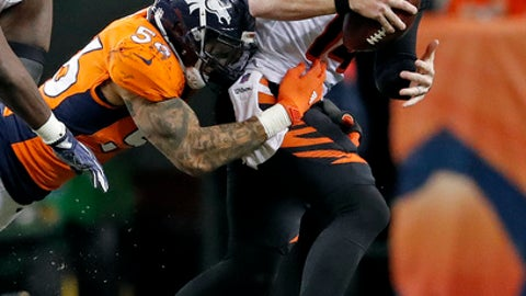 Cincinnati Bengals quarterback Andy Dalton (14) is hit by Denver Broncos outside linebacker Shane Ray (56) during the second half of an NFL football game, Sunday, Nov. 19, 2017, in Denver. (AP Photo/Jack Dempsey)