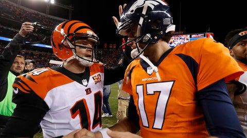 Denver Broncos quarterback Brock Osweiler (17) and Cincinnati Bengals quarterback Andy Dalton (14) meet after an NFL football game, Sunday, Nov. 19, 2017, in Denver. The Bengals won 20-17. (AP Photo/Jack Dempsey)