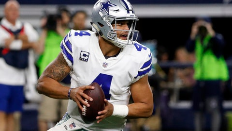 Dallas Cowboys quarterback Dak Prescott (4) drops back to pass against the Philadelphia Eagles in the first half of an NFL football game, Sunday, Nov. 19, 2017, in Arlington, Texas. (AP Photo/Michael Ainsworth)
