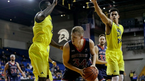 Saint Mary's center Jock Landale (34) is defended by San Jose State center Oumar Barry, left, and guard Isaiah Nichols (10) during the second half of an NCAA college basketball game, Sunday, Nov. 19, 2017, in San Jose, Calif. (AP Photo/Marcio Jose Sanchez)